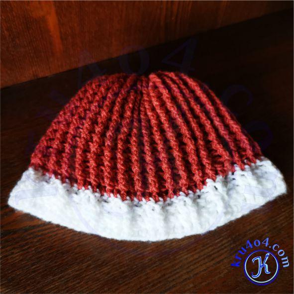 Получившаяся мужская шапка по голове связанная резинкой.